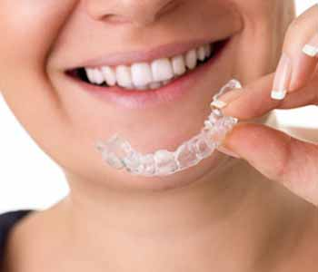 Dr. Imam Mohammed Attractive, comfortable features make Invisalign a perfect complement with holistic practice in Maine